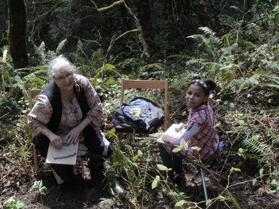 Ellen Brotherson sculpts clay at Marquam Nature Park with granddaughter Fatima Brotherson-Erriche.