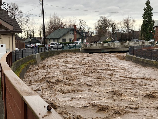 Mill Creek at Whitman College in Walla Walla was running high and brown with quick melt and agricultural runoff Friday, Feb. 2, 2020.