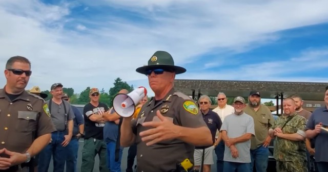 "In this screenshot from a YouTube video, Lewis County Sheriff Robert Snaza tells a crowd ""Don't be a sheep"" when it comes to following Gov. Jay Inslee's face covering order."