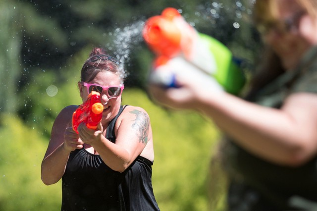 Dozens of people brought their water weapons for the Seventh Annual Water Gun Fight in Laurelhurst Park Sunday, July 30, 2017.