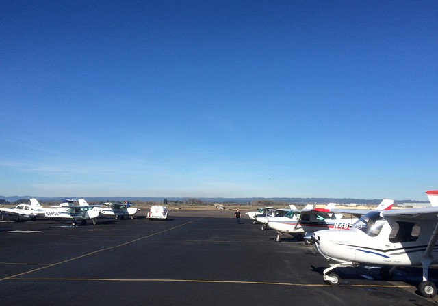 Airplanes line the tarmac at the airport in Hillsboro, Oregon. The airport is considering supplying unleaded fuel. Many piston-engine aircraft like small planes and helicopters use aviation gas, a fuel that contains lead. Environmental advocates have called on the U.S. Environmental Protection Agency to end the use of lead in aviation fuel.