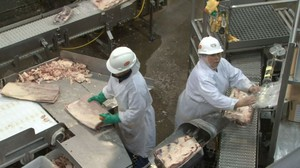 File photo of a Tyson Foods meat processing plant. A Tyson facility in Wallula, Washington, is dealing with an expanding coronavirus outbreak.
