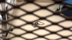 Metal handcuffs lie on the floor of a medical facility at Guantánamo Bay, Cuba, in October 2018.