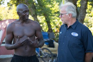 "Steve Spinnett talks with Otis ""Diamond"" Britton, a homeless man who lives on the Springwater Corridor Trail. Spinnett and Britton have become friends."