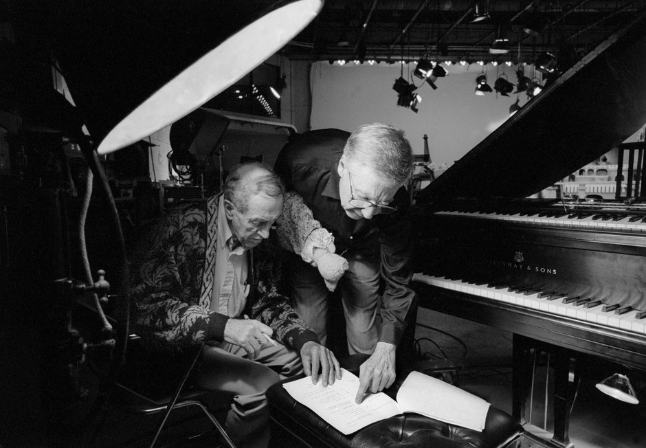 Fred, puppet still on hand, confers with musician and Neighborhood regular Joe Negri in 1992. The two had a deep friendship and creative relationship for years on and off the set.