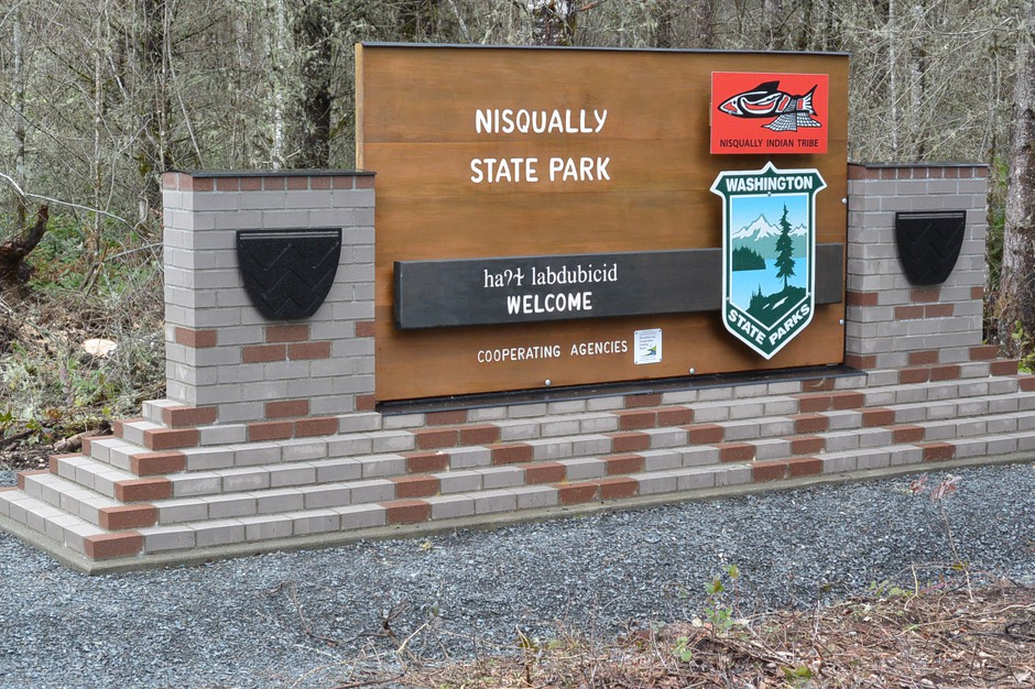 The new entrance sign telegraphs the state-tribal partnership to manage the new state park.