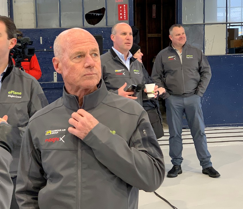 Harbour Air CEO and test pilot Greg McDougall in the company hangar Tuesday with MagniX CEO Roei Ganzarski standing over his left shoulder.