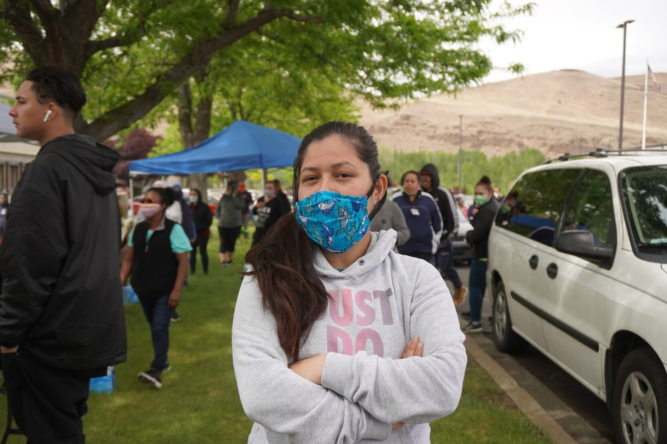 Perla Torres, a fruit packer at Jack Frost Fruit, poses for a photograph wearing a mask she says she bought from a supervisor.