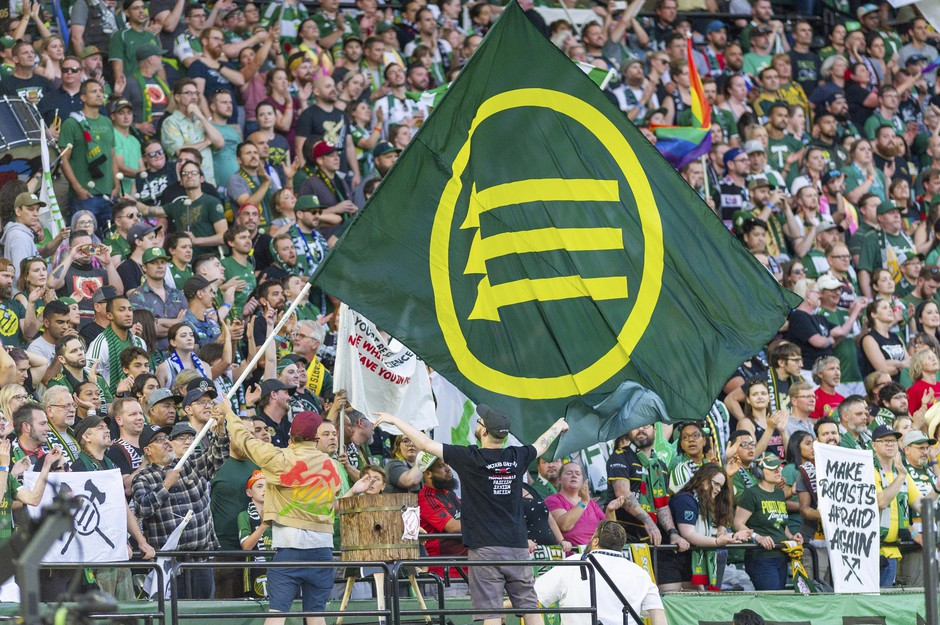 """At minute 33 of the first half, the Timbers Army supporters group break their silence and displays numerous flags and versions of the iron front symbol as they sing and old Italian Partisan song, """"Bella Ciao"""", during the Seattle Sounders 2-1 victory over the Portland Timbers at Providence Park on August 23."""
