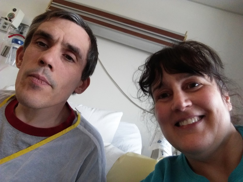Christopher Davis poses for a selfie with his sister Deborah Davis. Christopher is one of hundreds of people who are stuck in Washington hospitals because of a lack of community placements.
