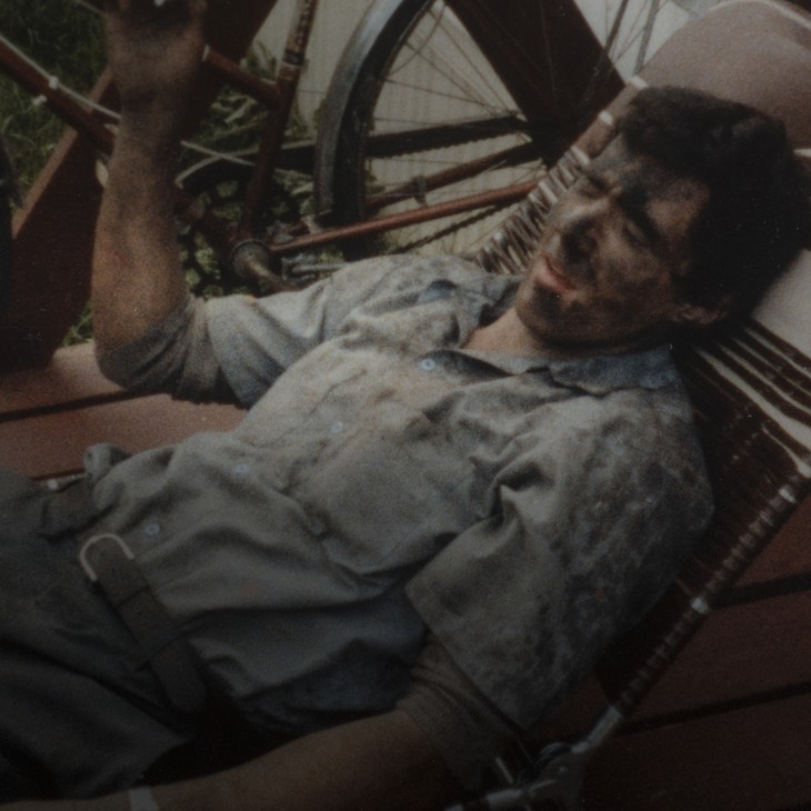 An old photograph of Kelly taken when he was 19 captures him taking a break after working in the mines.