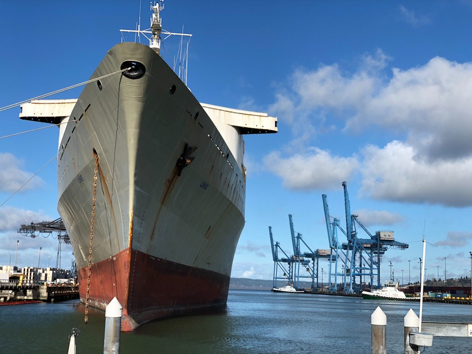 At Washington's Port of Tacoma, cargo containers and ships are moving much more slowly back from China while U.S. commodities are competing for space to ship out.