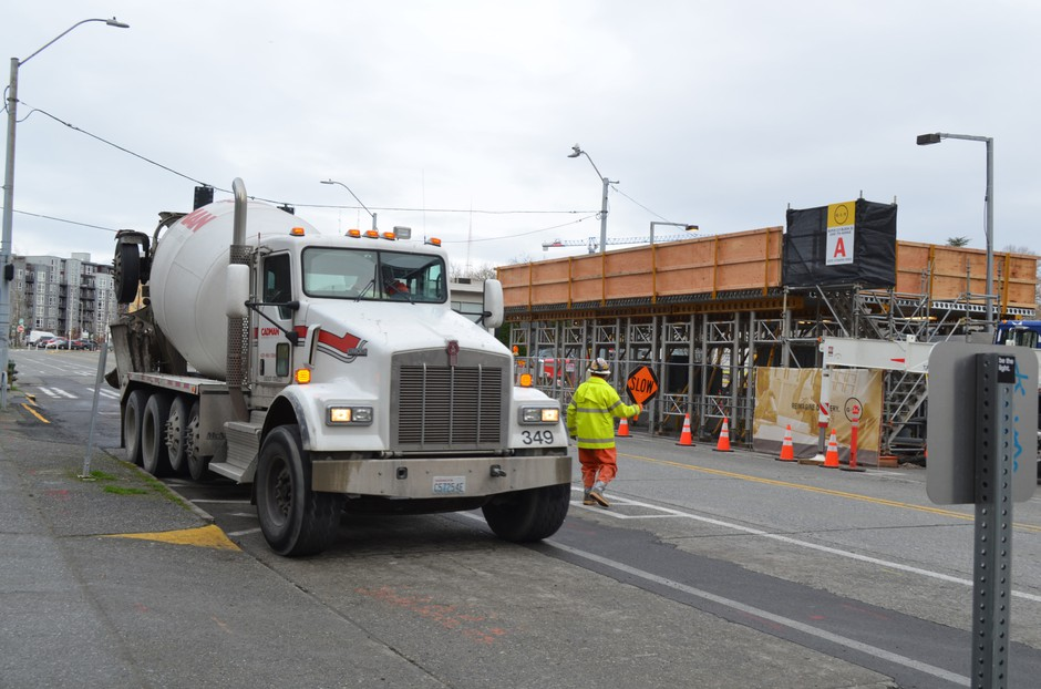 Cement trucks line up at a construction site in South Lake Union.