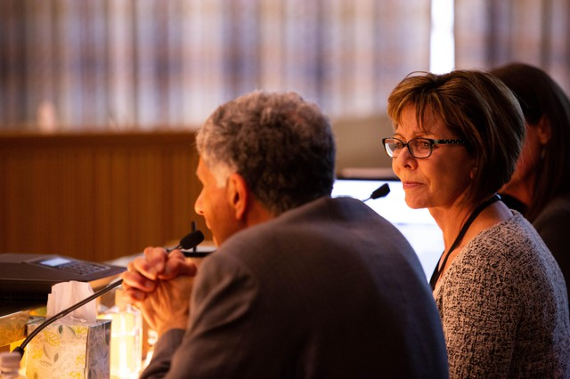 Oregon Child Welfare director Marilyn Jones, right, listens to Department of Human Services director Fariborz Pakseresht deliver testimony before the Senate Human Services Committee Thursday, April 10, 2019, at the Capitol in Salem, Ore.