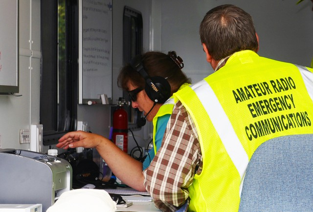 Members of the Oregon Office of Emergency Management's Amateur Radio unit conducting a statewide Simulated Emergency Test using High Frequency Radio in the OEM's Continuity of Operations Trailer.