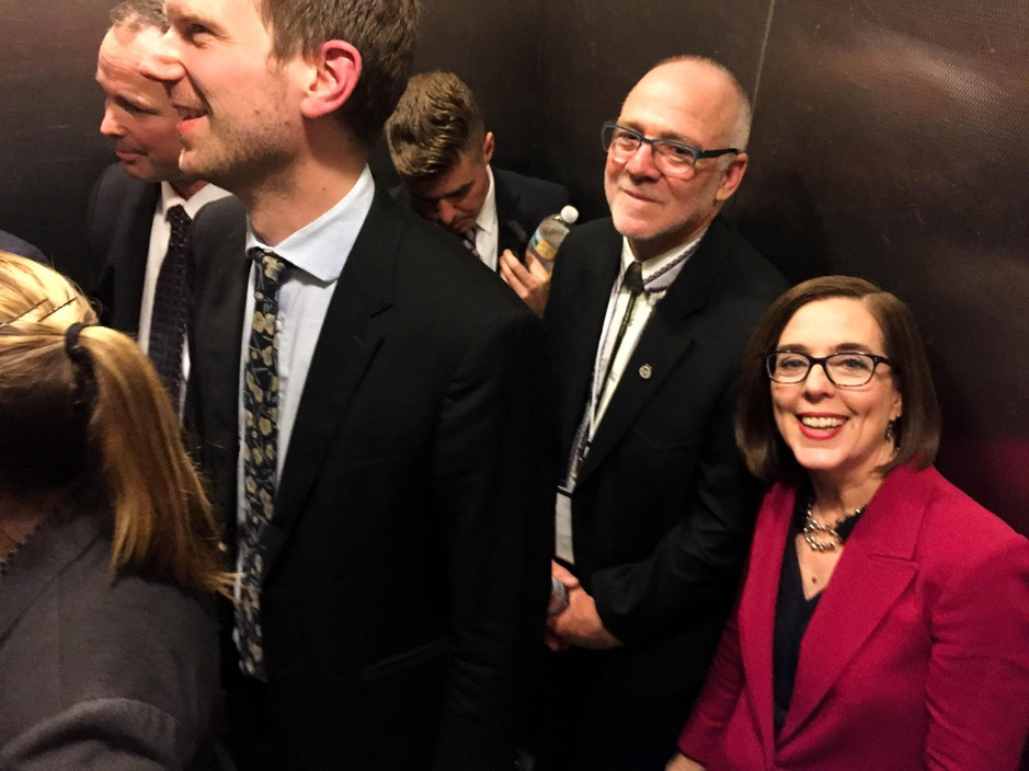 Oregon Gov. Kate Brown and her husband, Dan Little, are all smiles in an elevator after her victory over Republican state Rep. Knute Buehler in the hotly contested governor's race.