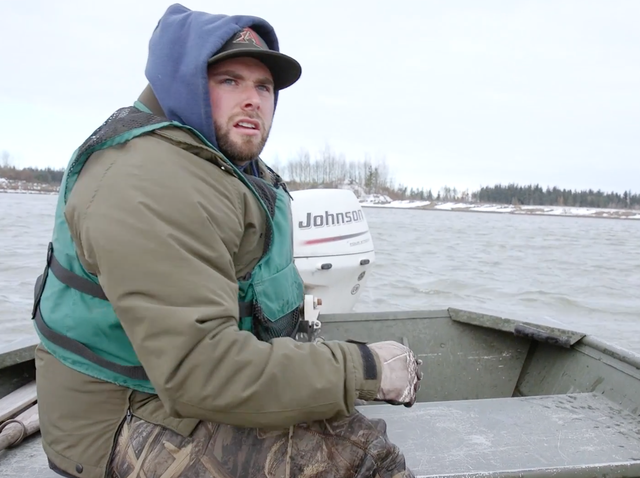 Daniel Zimmerman is a biologist with the Washington Department of Fish and Wildlife. He is pictured here patrolling Judson Lake on the border with British Columbia for trumpeter swans that need treatment for lead poisoning.