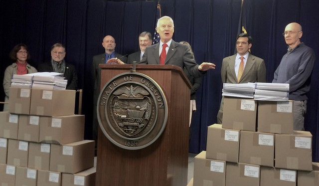 Oregon Secretary of State Dennis Richardson spoke surrounded by blank voter registration forms, which were meant to represent inactive voters.