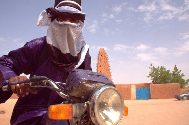 """Tuareg guitarist, Mdou Moctar, starred in Christopher Kirkley's 2015 film """"Akounak Tedalat Taha Tazoughai,"""" which translates as """"Rain the Color of Blue with a Little Red In It."""""""