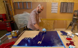 Artist Ben Buswell works on his latest piece