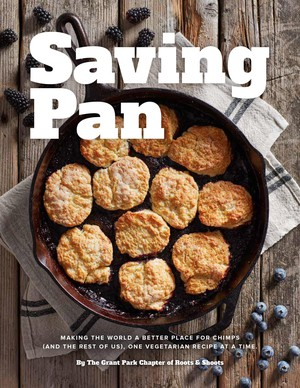 """The """"Saving Pan"""" cover features a blackberry-blueberry cobbler made in a cast-iron skillet, one of three meanings of """"pan"""" in the book title. The others references are the genus name for two chimpanzee species and a character in a popular children's story about lost childhood."""