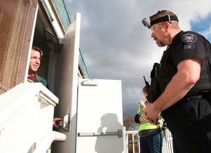 Hillsboro police officer Stewart Kelsey (right), responds to a mock call during a recent training exercise. Curious Comedy's Nate May (left) is playing a man experiencing delusions.