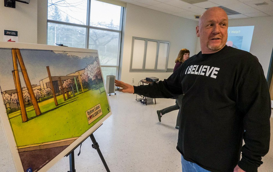 Alan Evans shows off a rendering of his vision for Wapato Jail.