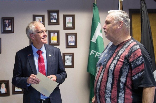 During a campaign stop in September, Bud Pierce (left) talks with a supporter at All Military Veterans Outreach Organization, a Clackamas County non-profit.