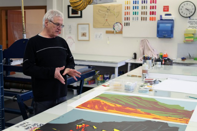 Master printer Frank Janzen finishing up several prints for the artist James Lavadour at the Crow's Shadow Institute of the Arts.