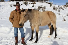 """Tom Sharp with his horse, """"Buck"""" at his ranch outside of Burns."""