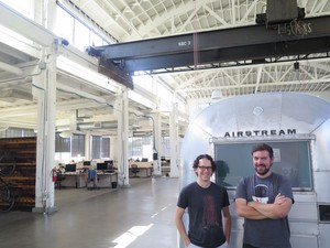 "Andy Baio (left) and Andy McMillan (right) have always been drawn to unfinished spaces, whether it was hosting XOXO fest 2014 in the under-wired Redd building or the airy warehouse they picked for the Outpost. At this point, to work in a completed building, McMillan jokes, ""almost feels like cheating."""