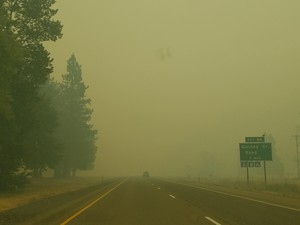 Smoke limits visibility on Interstate 5 near the Quines Creek Road exit, 12 miles south of Canyonville, Ore., July 27 2019.
