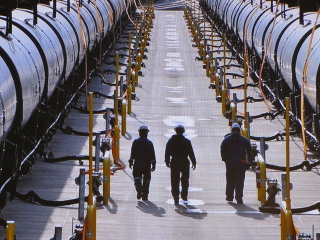 Workers prepare oil trains for unloading at the Tesoro Refinery north of Seattle.