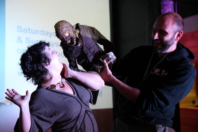 """For the zombie puppet Zed, threatening to eat someone — say host April Baer — is just another way of saying hello. He stars in """"Frank & Zed"""" by filmmaker Jesse Blandard (right)."""