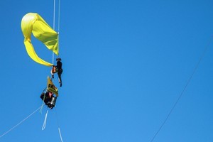 A protester releases a flag that was lowered down from the St. Johns Bridge Wednesday, July 29, 2015. Protesters hung from the bridge in protest to block a Shell icebreaker which was scheduled to return to Alaska.