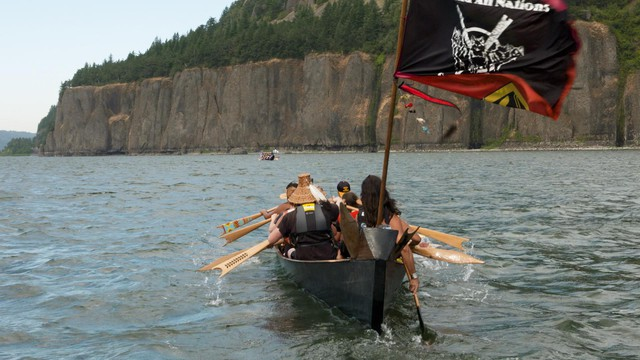Members of the Portland All Nations Canoe Family pull 21 river miles on the fifth leg of their Canoe Journey from Beacon Rock to Washougal, Washington.