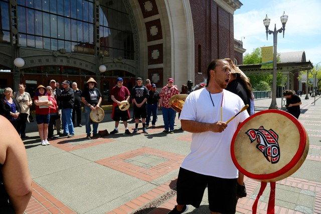 The Chinook Indian Nation gather outside a federal courthouse in Tacoma to rally support for federal recognition.