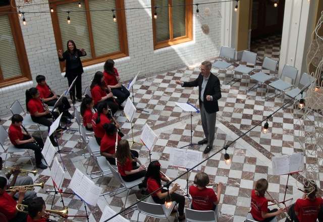 Portland Mayor Ted Wheeler conducts members of BRAVO Youth Orchestras. BRAVO is one of several dozen organizations — along with hundreds of individual artist — who receive public funding through the Regional Arts and Culture Council.