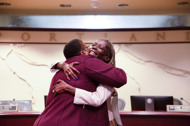 Commissioner Jo Ann Hardesty embraces judge Adrienne Nelson after taking the oath of office.