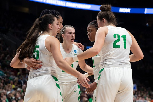Oregon Ducks basketball players huddle during the first half of an NCAA Tournament game against South Dakota State on Friday, March 29, 2019, at Moda Center in Portland, Ore. Oregon won 63-53.