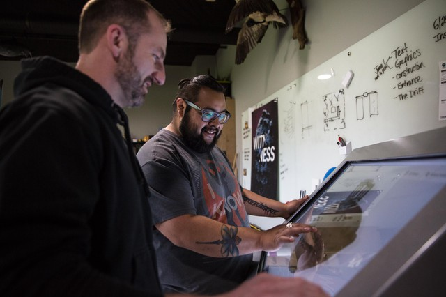 Dustin Hawks, left, and Nicolas Atanacio manipulate a 3D scan of a horn bowl in the cultural interpretation room at Chachalu Museum and Cultural Center in Grand Ronde, Ore., Tuesday, May 21, 2019. The Confederated Tribes of Grand Ronde have scanned, studied and injected new life into artifacts that previously spent more than a century stored in London before temporarily returning home last year.