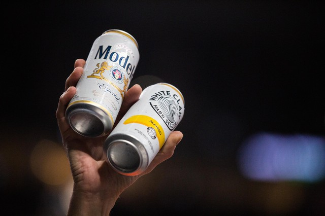 A vendor holds up a Modelo Especial beer and a White Claw hard seltzer during a National Basketball Association game between the Portland Trail Blazers and the Toronto Raptors at the Moda Center in Portland, Ore., Wednesday, Nov. 13, 2019.TheModa Center began selling White Claw in 2019.