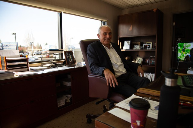 Jon Creedon, president of Vancouver Auto Group, sits in his office on March 20. Creedon said auto sales have dropped, but he expects they will rebound.