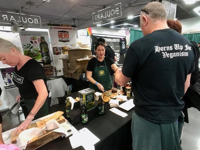 Horns Up for Veganism is one of many messages circulating in an Oregon Convention Center exhibit hall on Oct. 21, 2018, during the 14th annual Portland VegFest.