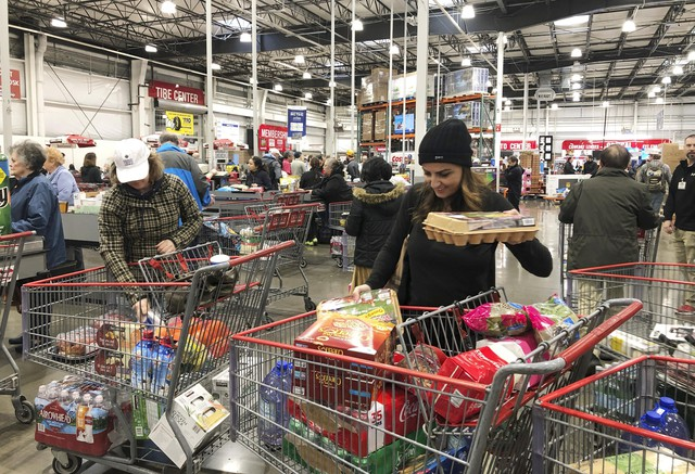 Shoppers visit a Costco Wholesale in Tigard, Ore., Saturday, Feb. 29, 2020, after reports of Oregon's first case of coronavirus was announced in the nearby Oregon city of Lake Oswego on Friday.