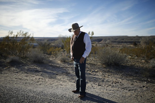 Rancher Cliven Bundy stands along the road near his ranch Jan. 27, 2016, in Bunkerville, Nevada.