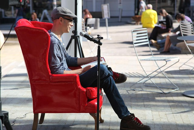 "Author Daniel H. Wilson reads from his book ""Robopocalypse"" at a Red Chair reading in Directors Park."