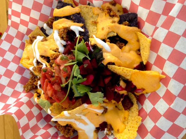 For a culinary cage match with meat-based nachos, let Paige Common of Eatin' Alive weigh in. Her guilt-free nach'yos are a healthful combo that might leave you feeling pretty perky come Monday morning.