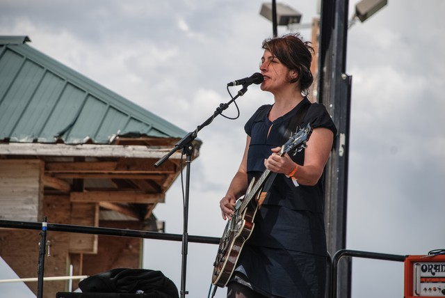 Rebecca Gates playing lead guitar with The Consortium at the Sasquatch Music Festival in 2011