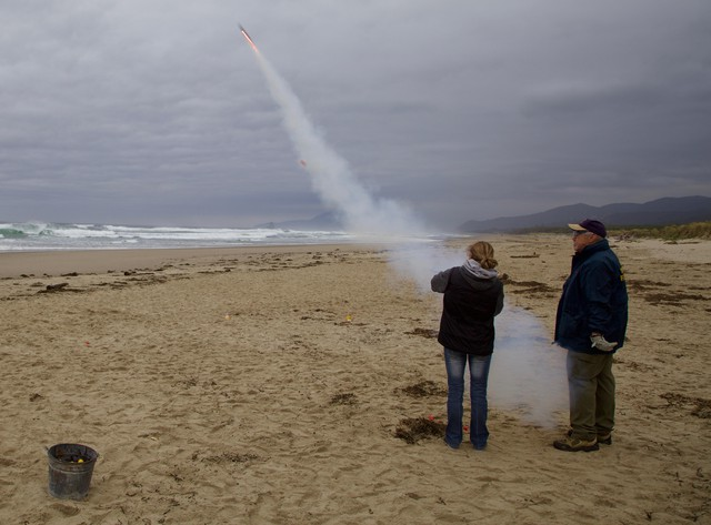 Students learn how to safely fire parachute flares.